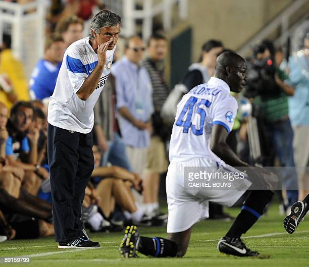 Chelsea FC head coach Jode Mourinho speaks to striker Mario Balotelli during the 2009 World Football Challenge game Chelsea FC vs Inter Milan at the...