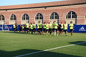 Chelsea FC players warm up before a training session after arriving after a long flight at UCLA on July 24 2016 in Los Angeles California