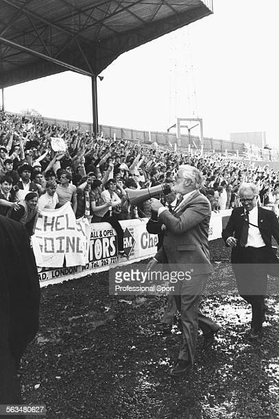 Chelsea Football Club Chairman Ken Bates uses a tannoy to appeal to fans to stay off the pitch after the team won 50 against Leeds United at Stamford...