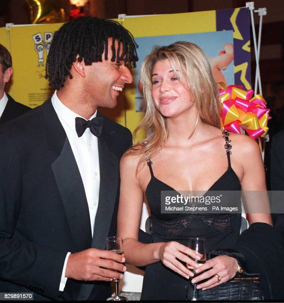 Chelsea Football Club player manager Ruud Gullit accompanied by his girlfriend Estelle Cruyff attends the SPARKS Ball at the Hilton Hotel on Park...