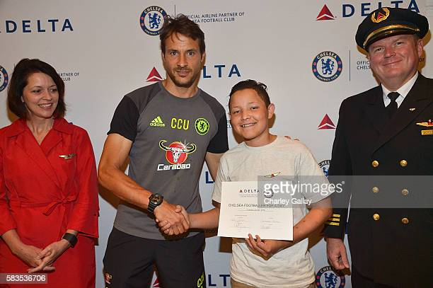 Chelsea Football Club's Carlo Cudicini and Children's Hospital Los Angeles patient Christopher Escobar with Delta Air Lines brand ambassadors join...
