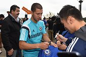Chelsea football player Eden Hazard signs autographs for fans in front of the Sydney Opera House in Sydney on May 31 2015 The English Premier League...