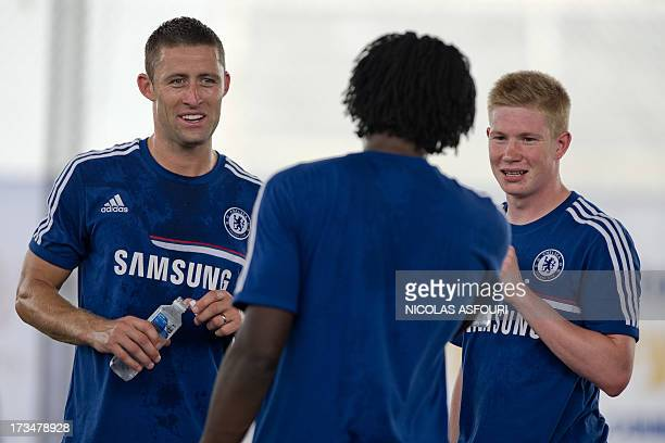 Chelsea football player Gary Cahill Romelu Lukaku and Kevin De Bruyne chat during an exhibition training with Thai children at the super kick stadium...