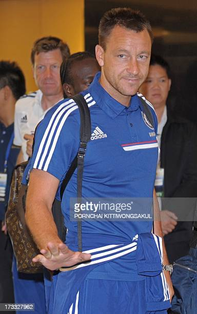 Chelsea football player John Terry gestures to media after arriving at Suvarnabhumi International Airport in Bangkok on July 12 2013 Chelsea football...