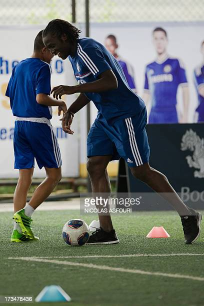 Chelsea football player Romelu Lukaku play with the ball during an exhibition training with Thai children at the super kick stadium in Bangkok on...