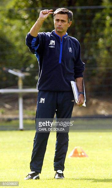 Chelsea Football team's newly appointed Manager Jose Mourinho talk to his players at the training session at Chelsea Football Team's training grounds...