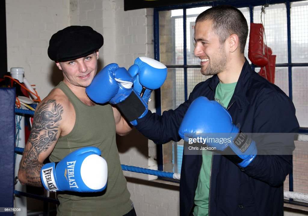 Chelsea footballer <a gi-track='captionPersonalityLinkClicked' href=/galleries/search?phrase=Joe+Cole&family=editorial&specificpeople=171525 ng-click='$event.stopPropagation()'>Joe Cole</a> steps into the boxing ring with Kevin Mitchell during a photocall with his friend and World Title Challenger at TKO Ultrachem Gym on April 15, 2010 in Luton, England. Kevin Mitchell will fight Michael Katsidis on May15th.