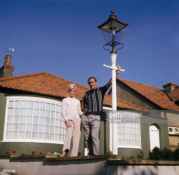 Chelsea footballer Ron Harris outside his home with his wife Lee and their lamppost