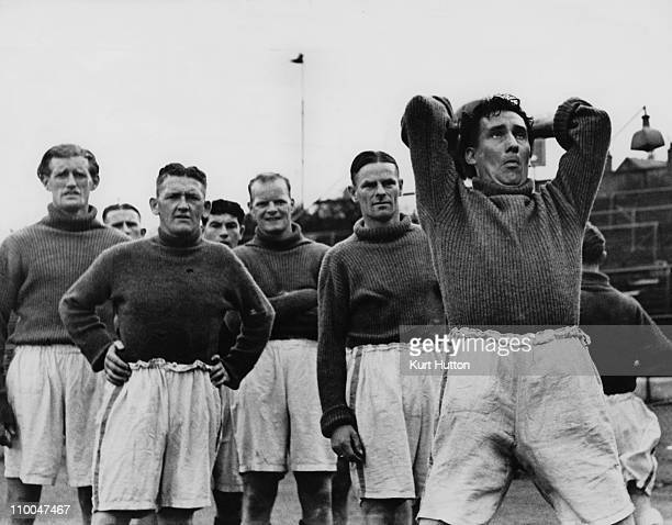 Chelsea footballers George Barber John O'Hare Robert Salmond John Jackson and Sam Weaver during training at Stamford Bridge London August 1939...