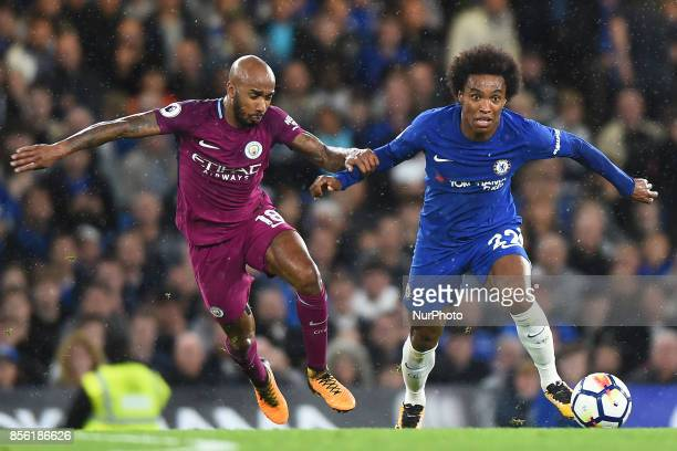 Chelsea Forward Willian fends off Manchester City midfielder Fabian Delph during the Premier League match between Chelsea and Manchester City at...