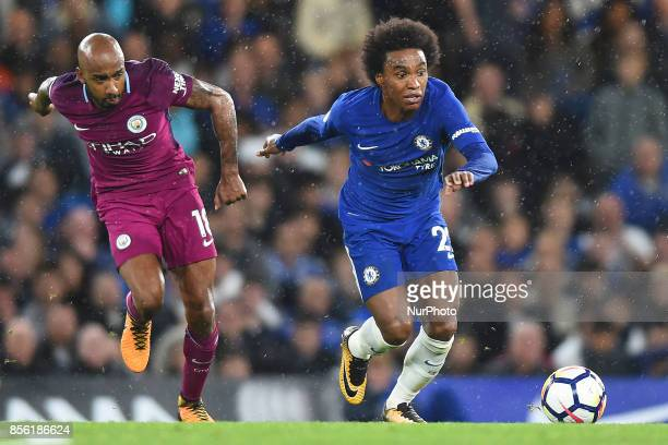 Chelsea Forward Willian runs off Manchester City midfielder Fabian Delph during the Premier League match between Chelsea and Manchester City at...