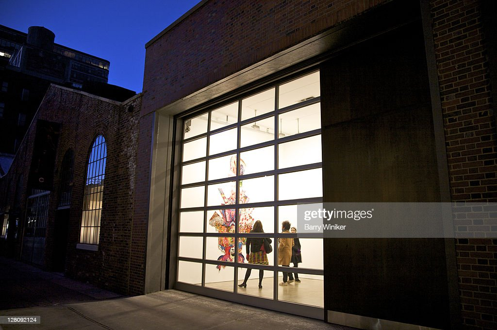 Chelsea gallery on West 26th Street at dusk, New York, NY, U.S.A.