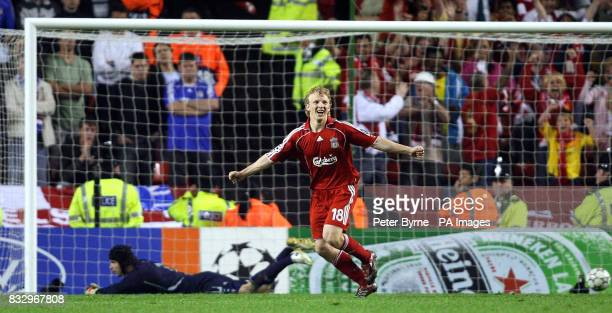 Chelsea goal keeper Petr Cech lays dejected as Liverpool's Dirk Kuyt celebrates scoring the winning penalty during the UEFA Champions League...