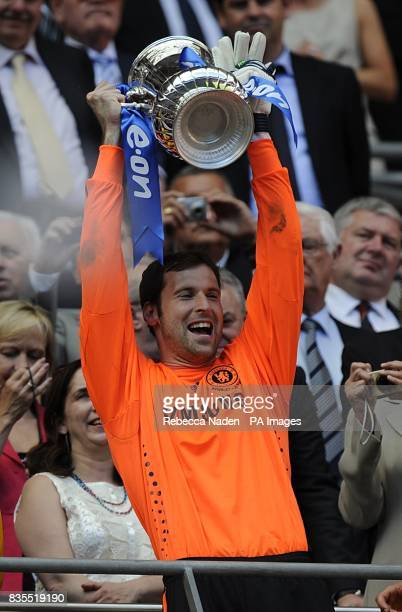 Chelsea goalkeeper Petr Cech celebrates in the stands with the FA Cup Trophy