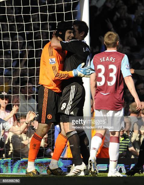 Chelsea goalkeeper Petr Cech celebrates saving a penalty from West Ham United's Mark Noble with teammate Frank Lampard