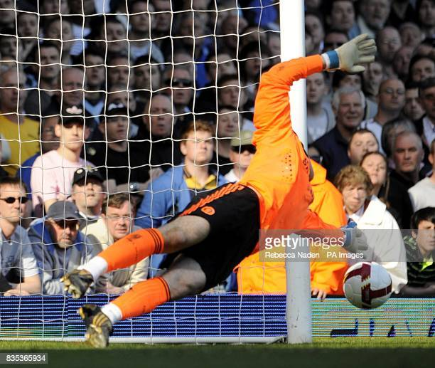 Chelsea goalkeeper Petr Cech saves a penalty by West Ham United's Mark Noble