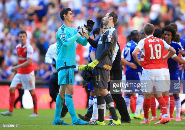 Chelsea goalkeeper Thibaut Courtois and Arsenal goalkeeper Petr Cech shake hands at the final whistle