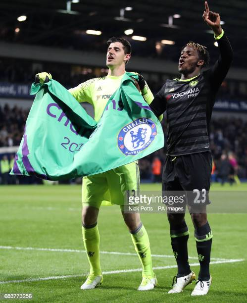Chelsea goalkeeper Thibaut Courtois and Chelsea's Michy Batshuayi celebrate after the final whistle