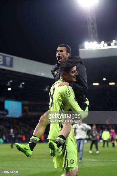 Chelsea goalkeeper Thibaut Courtois and Chelsea's Pedro celebrate after the game