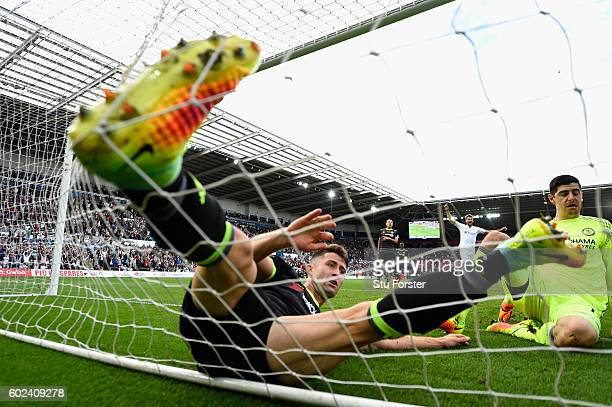 Chelsea goalkeeper Thibaut Courtois and Gary Cahill fail to stop the second Swansea goal scored by Leroy Fer during the Premier League match between...