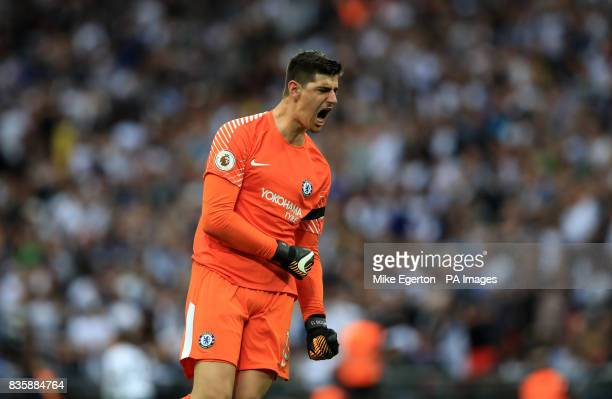 Chelsea goalkeeper Thibaut Courtois celebrates after his team score their second goal of the game during the Premier League match at Wembley Stadium...