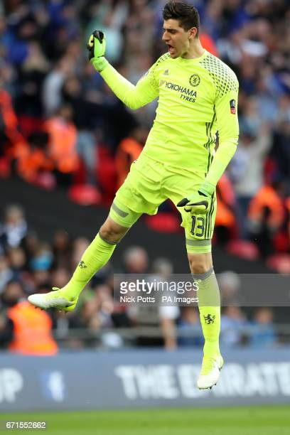 Chelsea goalkeeper Thibaut Courtois celebrates his side's fourth goal of the game during the Emirates FA Cup Semi Final match at Wembley Stadium...