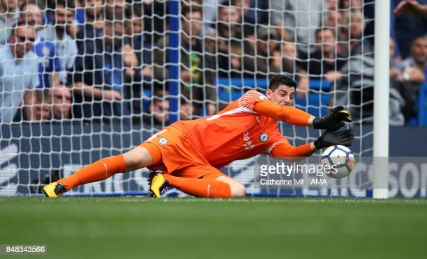Chelsea goalkeeper Thibaut Courtois makes a save during the Premier League match between Chelsea and Arsenal at Stamford Bridge on September 17 2017...