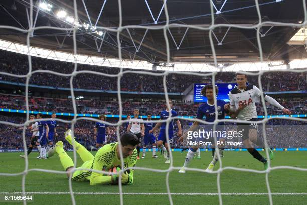 Chelsea goalkeeper Thibaut Courtois saves a freekick during the Emirates FA Cup Semi Final match at Wembley Stadium London