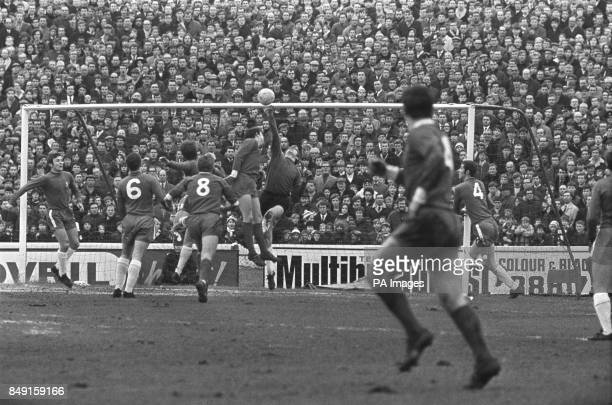 Chelsea goalkeeper Tommy Hughes pushes the ball over the bar to deny Ron Yeats a goal during a match against Liverpool at Stamford Bridge Also in the...