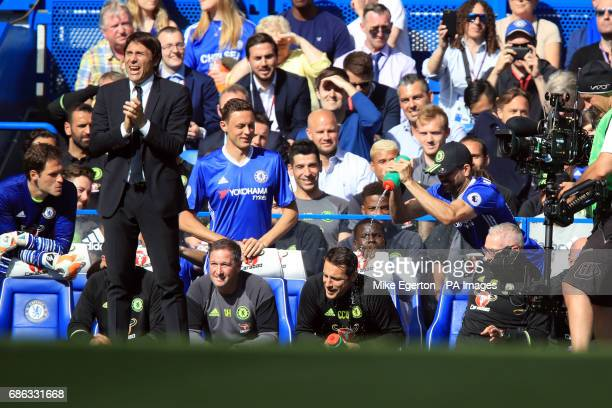 Chelsea goalkeeping coach Carlo Cudicini gets a soaking from Diego Costa as manager Antonio Conte looks on during the Premier League match at...