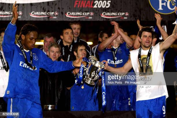 Chelsea goalscorers Didier Drogba and Mateja Kezman celebrate with the trophy