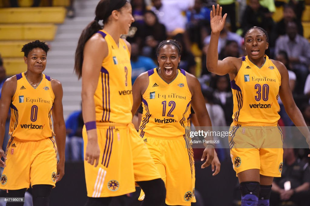 Chelsea Gray #12, Alana Beard #0 and Nneka Ogwumike #30 of the Los Angeles Sparks react to a play against the Phoenix Mercury in Game Two of the Semifinals during the 2017 WNBA Playoffs on September 14, 2017 at the Walter Pyramid, Long Beach State University in Long Beach, California.