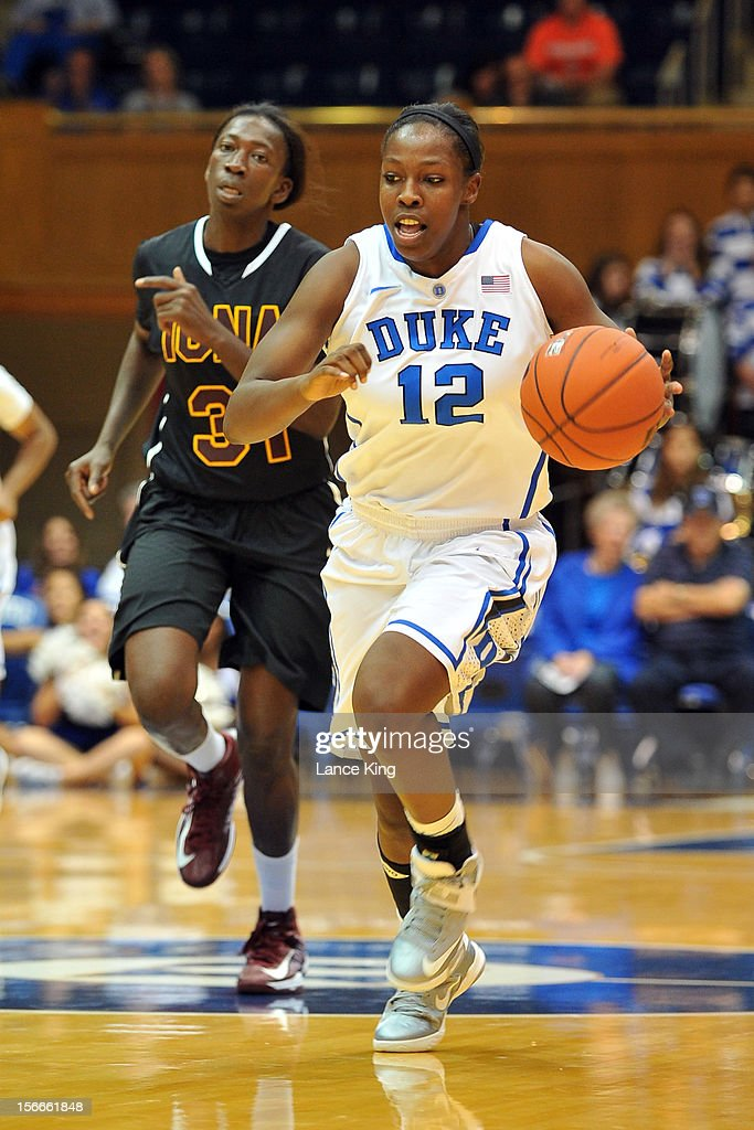 Chelsea Gray #12 of the Duke Blue Devils dribbles past Jiya Dorcas-Eya #31 of the Iona Gaels at Cameron Indoor Stadium on November 18, 2012 in Durham, North Carolina. Duke defeated Iona 100-31.