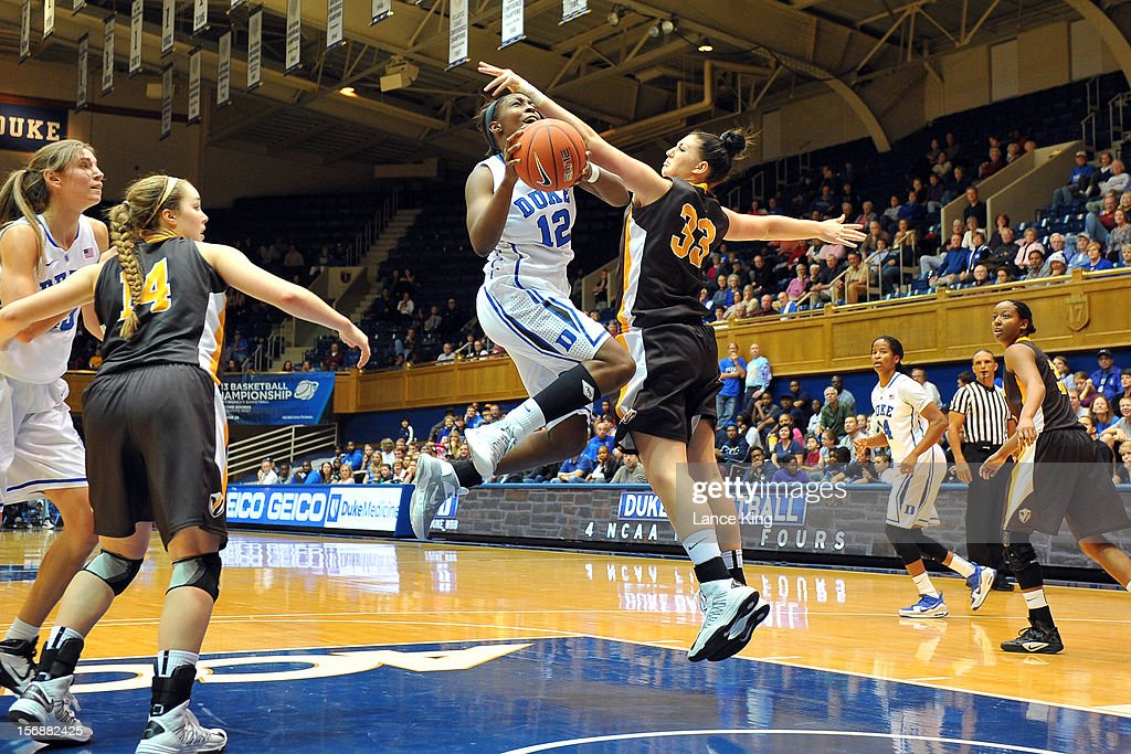 Chelsea Gray #12 of the Duke Blue Devils goes to the hoop against Maegan Callaway #33 of the Valparaiso Crusaders at Cameron Indoor Stadium on November 23, 2012 in Durham, North Carolina.