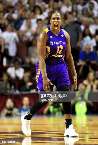 Chelsea Gray of the Los Angeles Sparks celebrates after making the game winning basket over the Minnesota Lynx during the fourth quarter of Game One...