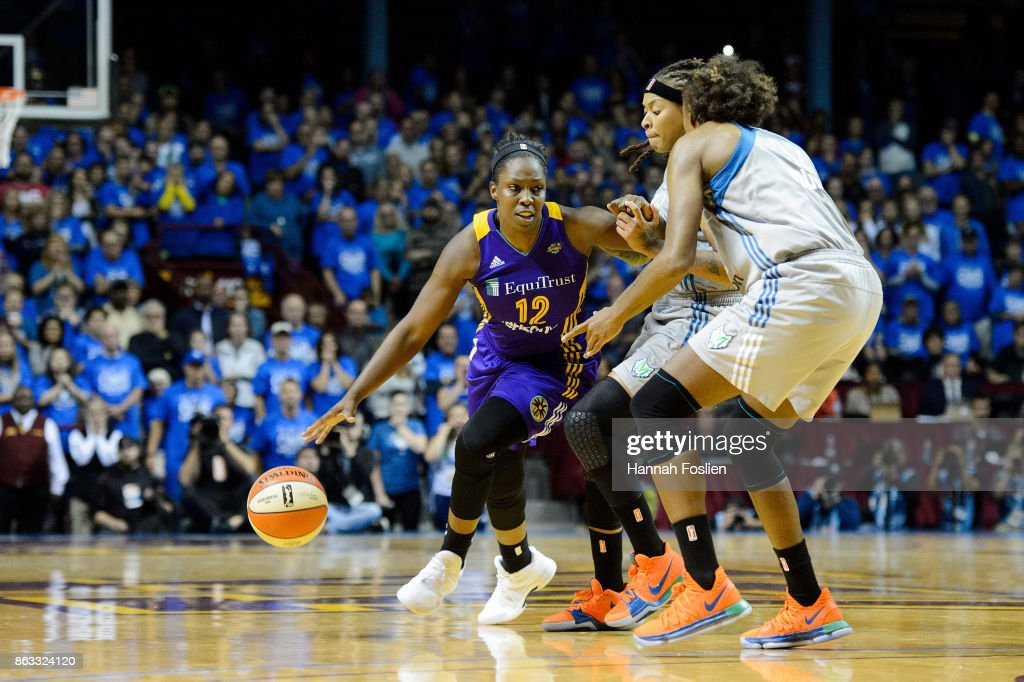 Chelsea Gray #12 of the Los Angeles Sparks drives to the basket against Seimone Augustus #33 and Rebekkah Brunson #32 of the Minnesota Lynx during the fourth quarter of Game Two of the WNBA Finals on September 26, 2017 at Williams in Minneapolis, Minnesota. The Lynx defeated the Sparks 70-68.