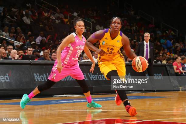 Chelsea Gray of the Los Angeles Sparks handles the ball against Kristi Toliver of the Washington Mystics on August 16 2017 at the Verizon Center in...