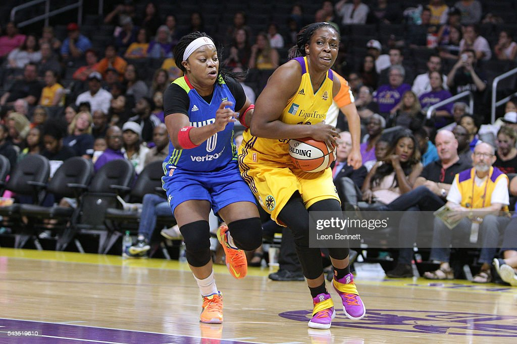 <a gi-track='captionPersonalityLinkClicked' href=/galleries/search?phrase=Chelsea+Gray&family=editorial&specificpeople=7420247 ng-click='$event.stopPropagation()'>Chelsea Gray</a> #12 of the Los Angeles Sparks handles the ball against <a gi-track='captionPersonalityLinkClicked' href=/galleries/search?phrase=Odyssey+Sims&family=editorial&specificpeople=7412276 ng-click='$event.stopPropagation()'>Odyssey Sims</a> #0 of the Dallas Wings during a WNBA basketball game at Staples Center on June 28, 2016 in Los Angeles, California.