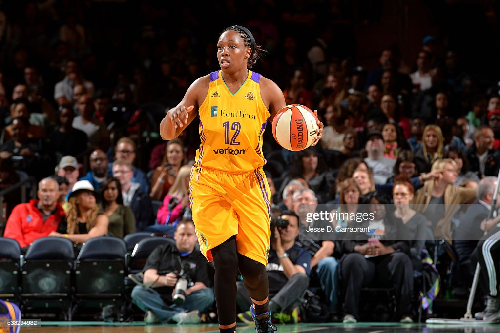 Chelsea Gray #12 of the Los Angeles Sparks handles the ball during the game against the New York Liberty on May 21, 2016 at Madison Square Garden in New York City, New York.