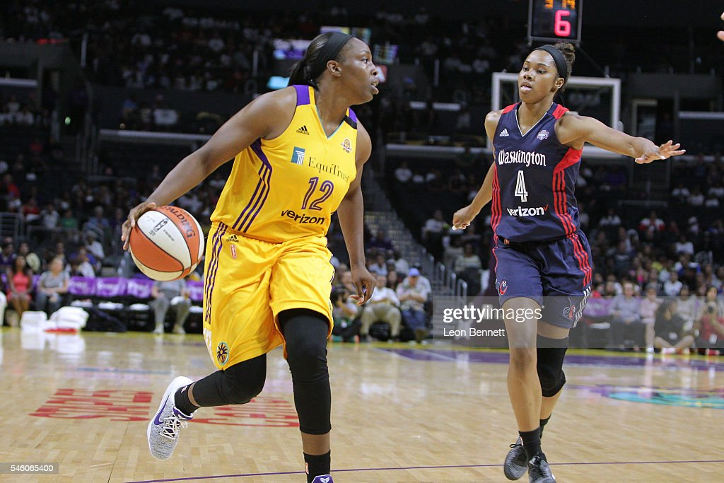 Chelsea Gray of the Los Sparks handles the ball against Tayler Hill of the Washington Mystics during WNBA basketball game at Staples Center on July...