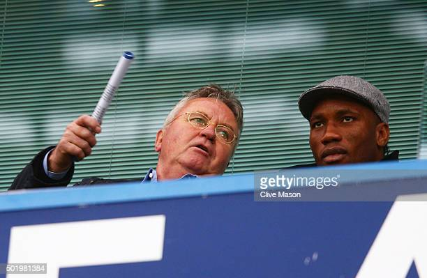 Chelsea interim manager Guus Hiddink and Didier Drogba of Montreal Impact talk on the stand prior to the Barclays Premier League match between...