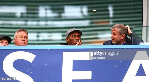 Chelsea interim manager Guus Hiddink Didier Drogba of Montreal Impact and Chelsea owner Roman Abramovich are seen on the stand during the Barclays...