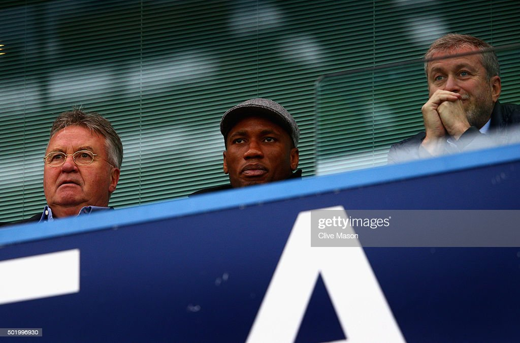 Chelsea interim manager <a gi-track='captionPersonalityLinkClicked' href=/galleries/search?phrase=Guus+Hiddink&family=editorial&specificpeople=214125 ng-click='$event.stopPropagation()'>Guus Hiddink</a> (L), <a gi-track='captionPersonalityLinkClicked' href=/galleries/search?phrase=Didier+Drogba&family=editorial&specificpeople=179398 ng-click='$event.stopPropagation()'>Didier Drogba</a> (C) of Montreal Impact and Chelsea owner <a gi-track='captionPersonalityLinkClicked' href=/galleries/search?phrase=Roman+Abramovich&family=editorial&specificpeople=208953 ng-click='$event.stopPropagation()'>Roman Abramovich</a> (R) are seen on the stand prior to the Barclays Premier League match between Chelsea and Sunderland at Stamford Bridge on December 19, 2015 in London, England.
