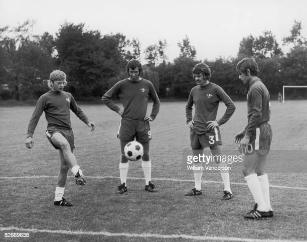 Chelsea Internationals Peter Osgood and Eddie McCreadie watch as the newly signed Wilkins brothers 17 yearold Graham and 15 yearold Ray show off...
