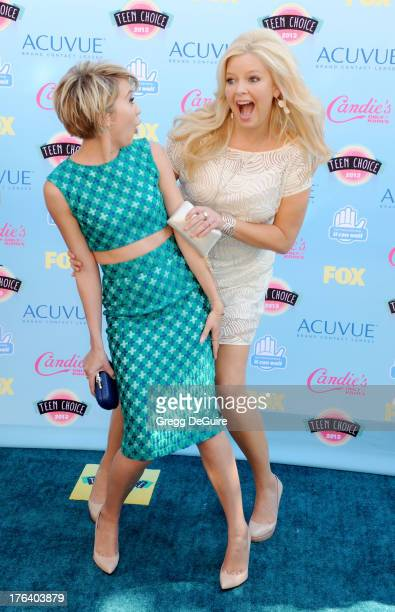 Chelsea Kane and Melissa Peterman arrive at the 2013 Teen Choice Awards at Gibson Amphitheatre on August 11 2013 in Universal City California