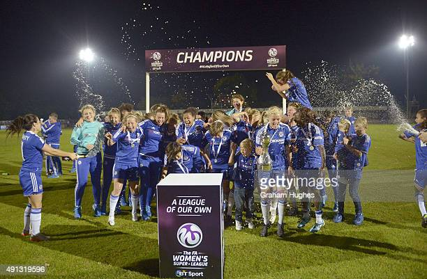 Chelsea ladies celebrate winning the FA WSL title after their match against Sunderland AFC Ladies on October 4 2015 in Staines England