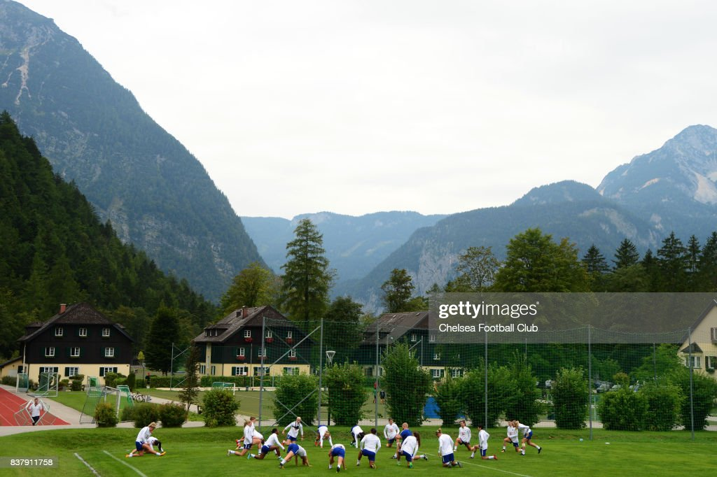 Chelsea Ladies warm up in front of mountains during a training session on August 23, 2017 in Schladming, Austria.