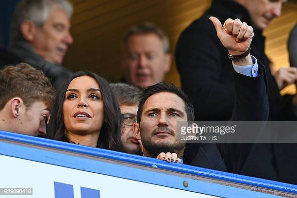 Chelsea legend Frank Lampard and his wife Christine Bleakley await kickoff in the English Premier League football match between Chelsea and West...