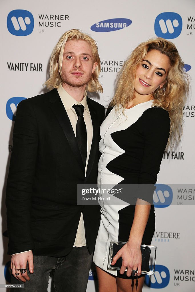 Chelsea Leyland and Dominic Jones attend the Warner Music Group Post BRIT Party In Association With Samsung at The Savoy Hotel on February 20, 2013 in London, England.