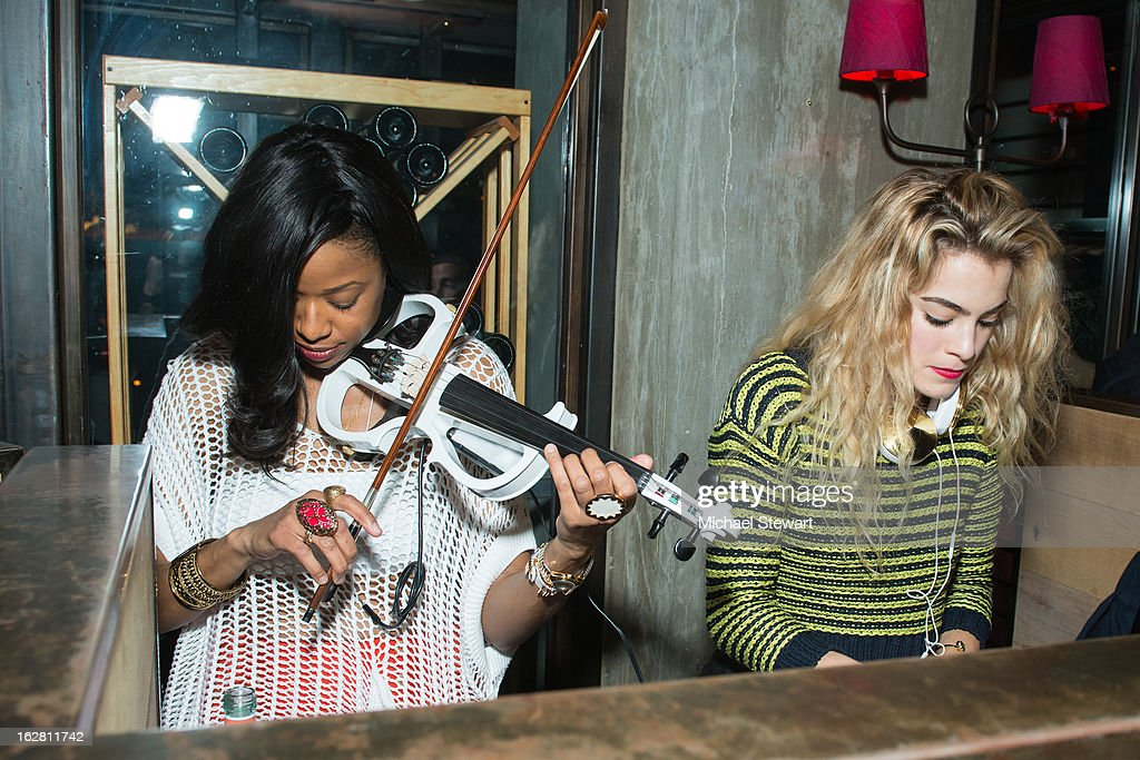 DJ Chelsea Leyland (R) and electric violinist perform during The ONE Group's Ristorante Asellina celebrates two years on Park Avenue South NYC at Ristorante Asselina on February 27, 2013 in New York City.